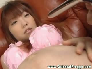 Oriental pregnant gets her hairy vagina opened wide