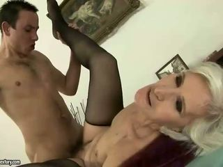 Horny granny riding young cock