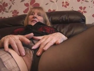 Busty blonde granny rips pantyhose to show off