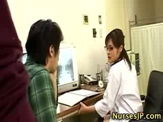 oriental nurse chick jerks off guy
