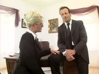 Platinum blonde secretary fucked in stockings and garter belt at the office
