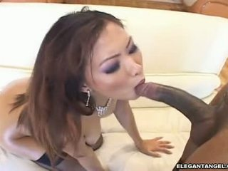 Scorching Lana Croft Fills Her Moist Mouth With An Excellent Darksome Shaft