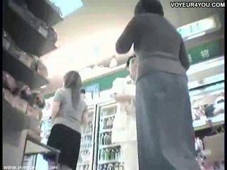 Sales clerks upskirt panties of asian babes.