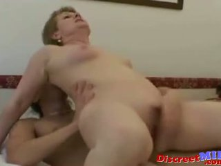Mature cougar seduces younger man and gets facial