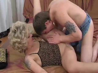 Horny blonde milf sucks and fucks young guy