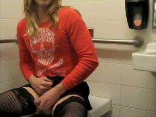 Sissy slut strokes in a public bathroom