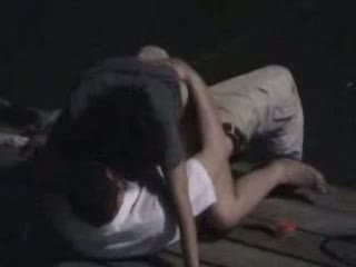 Couple fucking on pier at night
