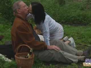 Brunette bitch fucks with old man in the woods