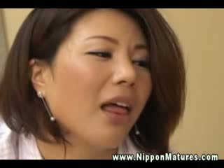 Hungry oriental milf sucking on fingers and boner