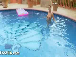 bigtit chick stripping in the pool