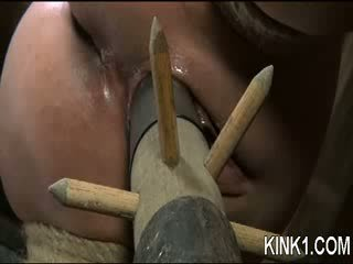 A spreader bar is all it takes to lay Nyssa out and keep her legs opened wide.
