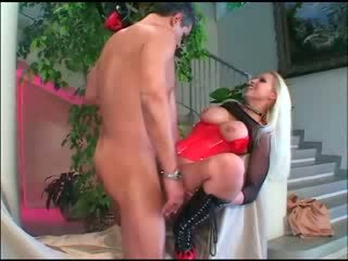 Busty blonde Nikki Hunter fucked in a corset fishnet lingerie and boots