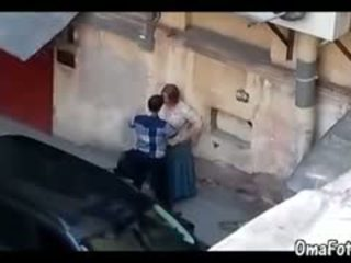 A Man Fucks Hard Chubby Mature's Mouth In Public