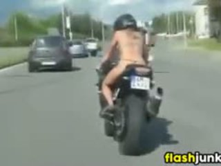 Topless Tattooed Chick Riding A Motorcycle