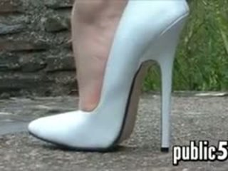 Very Tall And White High Heels Outdoors
