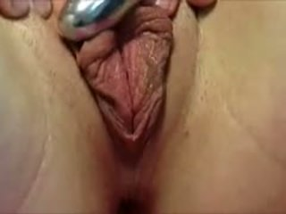 Rubbing Her Pussy Lips With A Vibrator