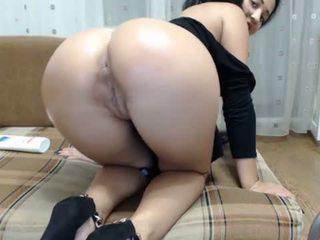 Hot brunette sat on a big dildo