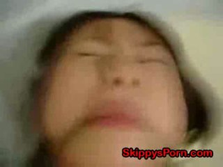 Young chinese tied to the bed