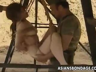 Asian slut hanging on some ropes fucked by the sol