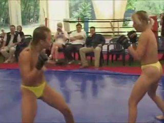 Topless women fight
