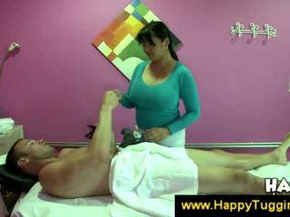 Busty asian masseuse offers a handjob