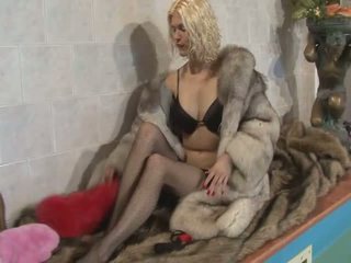 Two randy lesbians in long furry coats licking pussies