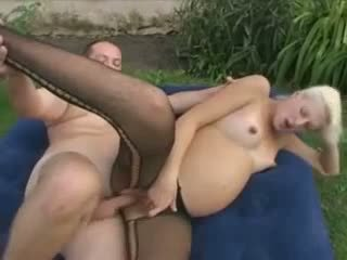 Pregnant blonde in fishnets fucked outdoor