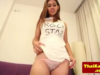 Young thai ladyboy wanking on couch