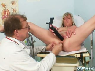 Horny blonde granny toys her pussy at gyno clinic