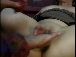 Hippie dude fingers corseted older lady's cunt and fists her ass