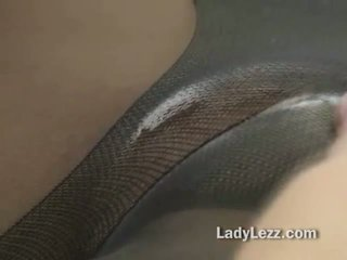 Lesbian seduces babe through pantyhose by putting her mouth on it