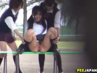 Uniformed Asians Pissing