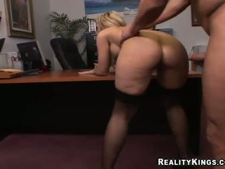 Busty blonde secretary riding a dick on a chair