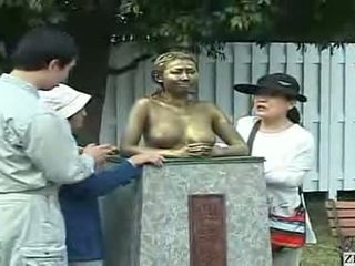 Tourists Playing With A Living Statue