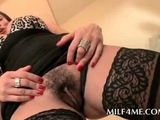 Aroused mom in lingerie rubs her hairy cunt