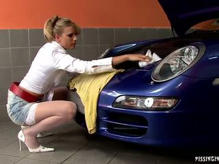 Two stunning blonde babes sharing one dick in the car workshop