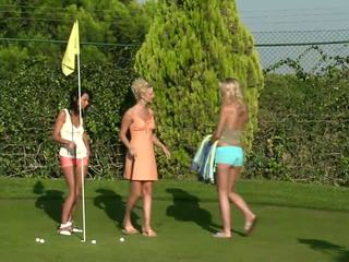 Debby and Jenny and Aneta stunning lesbian couple undressing in the golf course