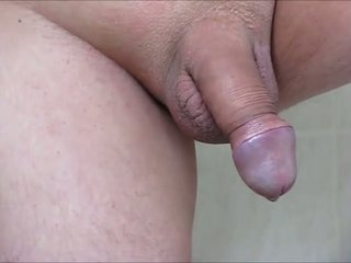Shaved Pissing Cock