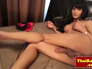 Asian ladyboy in lingerie pleasuring herself