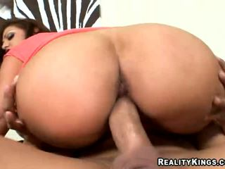 Brunette latina chick riding a dick on a sofa