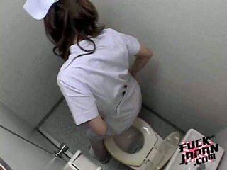 Sexy Japanese brunette masturbates hairy pussy on toilet