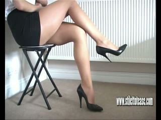 Hot Babe Teases Her Long Sexy Legs and Tapered High...